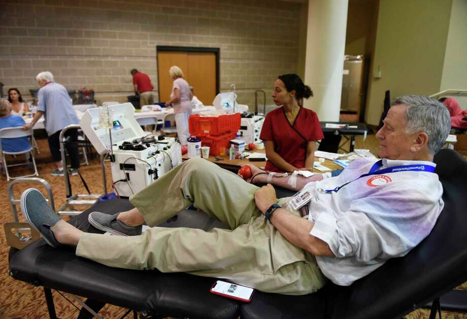 A Stamford man donates blood at the American Red Cross blood drive in Greenwich last year. Photo: File / Tyler Sizemore / Hearst Connecticut Media / Greenwich Time