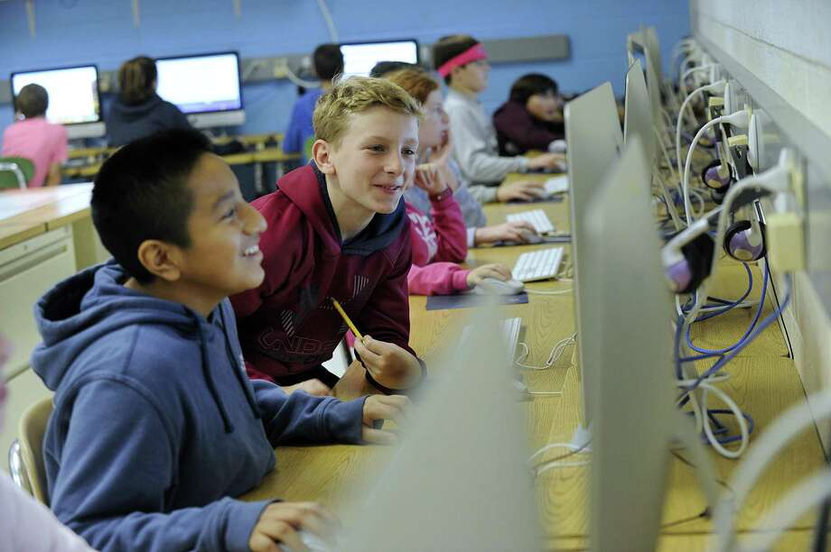 Jack Ginin, left, and Josh Macomber, both 11, during computer class at the Bethel Middle School. According to school officials, the school's 27-year-old chiller plant often fails in the heat and needs to be replaced. Photo: Carol Kaliff / Hearst Connecticut Media / The News-Times