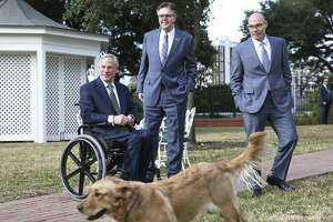 """Peaches"" streaks by after Governor Greg Abbott, Lt. Governor Dan Patrick and Speaker Dennis Bonnen speak at the Governor's Mansion on January 9, 2019. Both Patrick and Bonnen each raised more than $4 million from interest groups and wealthy donors from July to December in 2018, although Bonnen raised the bulk of that money after he declared in November he had secured enough votes to win the House speaker's race that would come in January."