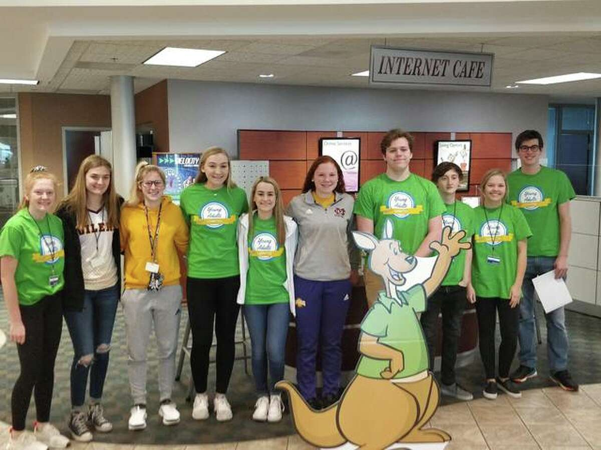 The RiverBend Growth Association's Young Adults Committee volunteered with the American Cancer Society, Southern Illinois Region at 1st MidAmerica Credit Union decorating rocks for cancer survivors.