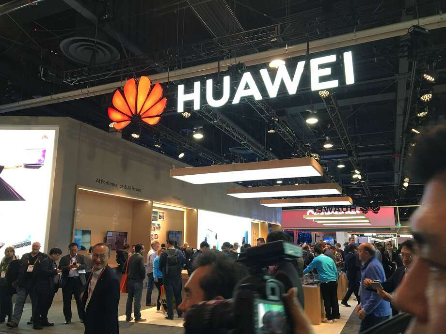 """(FILES) In this file photo taken on January 10, 2019, the Huawei booth is seen during CES 2019 consumer electronics show at the Las Vegas Convention Center in Las Vegas, Nevada. - US authorities are in """"advanced"""" stages of a criminal probe that could result in an indictment of Chinese technology giant Huawei, a published report said Wednesday, January 16, 2019. The Wall Street Journal, citing anonymous sources, said the Justice Department is looking into allegations of theft of trade secrets from Huawei's US business partners, including a T-Mobile robotic device used to test smartphones. The Justice Department declined to comment on the report. Huawei did not respond to an AFP request for comment. The move would further escalate tensions between the US and China after the arrest last year in Canada of Huawei's chief financial officer Meng Wanzhou, who is the daughter of the company founder. (Photo by Robert LEVER / AFP)ROBERT LEVER/AFP/Getty Images Photo: Robert Lever, AFP/Getty Images"""