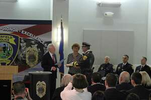 Chris Lyddy is sworn in as police chief by First Selectman Mike Tetreau.