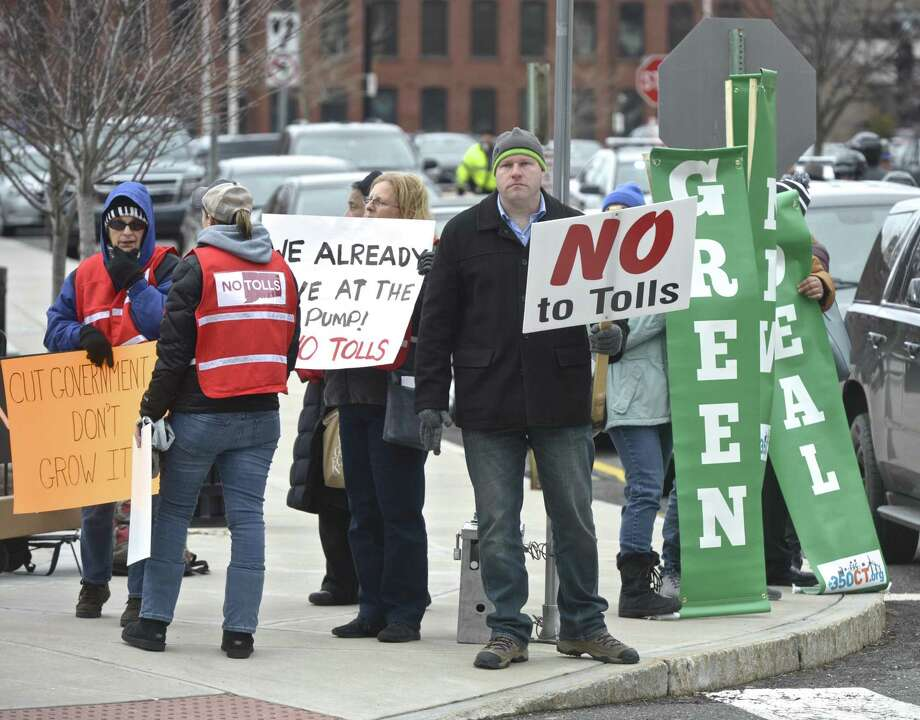 Patrick Sasser, of Stamford, center, was outside of Ned Lamont's Gubernatorial Inauguration on Wednesday trying to get the attention a legislators on the subject of hghway tolls. January 9, 2019, in Hartford, Conn. Photo: H John Voorhees III / Hearst Connecticut Media / The News-Times