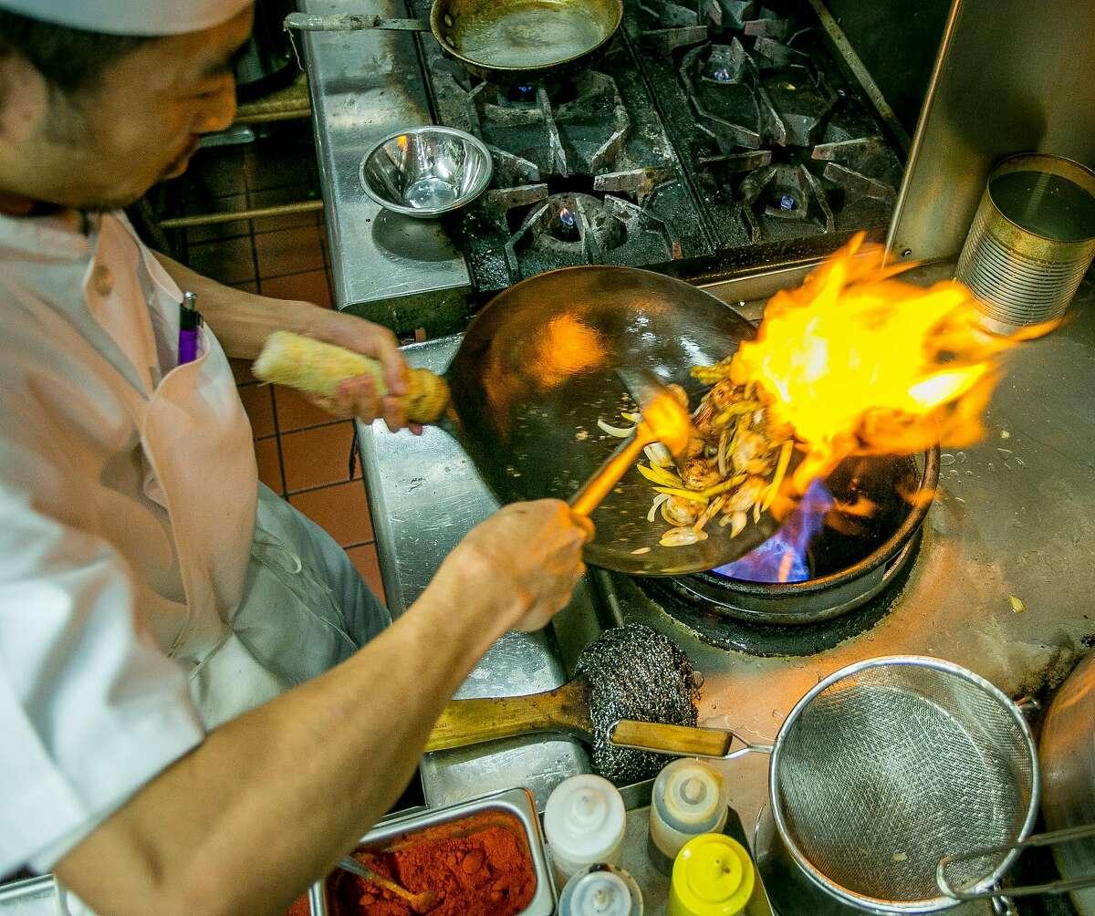 Chef Than Win makes Mango Shrimp at Rangoon Ruby in San Carlos, Calif., on November 7th, 2013.