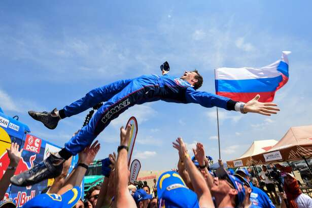 Kamaz truck Russian co-driver Evgenii Iakovle is congratulated by staff members after winning the Dakar Rally 2019, at the end of the last stage between Pisco and Lima, in Pisco Peru, on January 17, 2019. - Russia's truck driver Eduard Nikolaev, co-drivers Evgenii Iakovle and Vladimir Rybakov won the Dakar Rally 2019. (Photo by FRANCK FIFE / AFP) (Photo credit should read FRANCK FIFE/AFP/Getty Images)