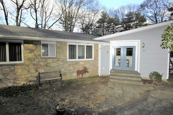 The house at 156 Old Dike Road has moved well beyond its humble roots as a simple fishing cottage. The home's original structure, which its listing agent claimed was built some time in the late 1950s, is the basement of the current home. Another floor was added, creating a 3,297-square-foot ranch. The property overlooks Pinewood Lake and offers spectacular views from nearly every room of the home, which has three bedrooms, three full bathrooms, and such interesting features as a full workshop underneath its two-car garage.