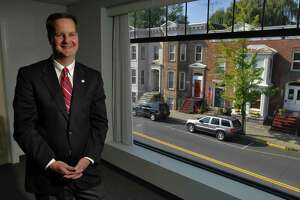 Times Union Staff photograph by Philip Kamrass -- Donald E. Gibson, President and CEO of The Bank of Greene County, stands in a conference room overlooking Main Street in Catskill, NY Thursday October 4, 2007. FOR BETSY FELDSTEIN PORTFOLIO STORY
