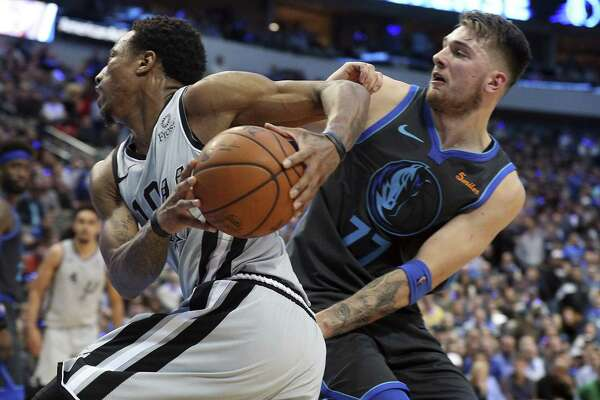 San Antonio Spurs guard DeMar DeRozan (10) tries to drive past Dallas Mavericks forward Luka Doncic (77) in the second half of an NBA basketball game, Wednesday, Jan. 16, 2019, in Dallas. (AP Photo/Richard W. Rodriguez)