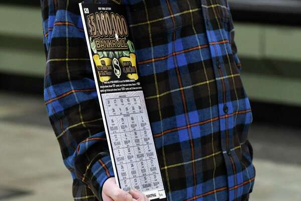 Jeremy Stark, 29, of Selkirk holds a copy of his $5 million scratch-off lottery ticket on Thursday, Jan. 17, 2019, at the Shop N Save supermarket in Ravena, N.Y. He took the lump-sum payment of $3,359,000. (Will Waldron/Times Union)