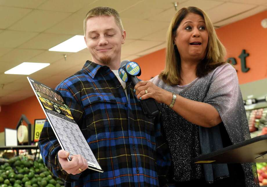 Jeremy Stark, 29, of Selkirk, left, is announced as the winner of a $5 million scratch-off lottery ticket by Yolanda Vega of the New York State Gaming Commission, right, on Thursday, Jan. 17, 2019, at the Shop N Save supermarket in Ravena, N.Y. (Will Waldron/Times Union) Photo: Will Waldron, Albany Times Union / 20045968A