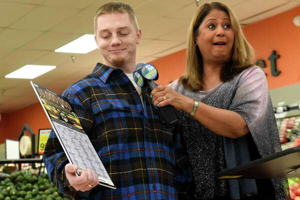 Jeremy Stark, 29, of Selkirk, left, is announced as the winner of a $5 million scratch-off lottery ticket by Yolanda Vega of the New York State Gaming Commission, right, on Thursday, Jan. 17, 2019, at the Shop N Save supermarket in Ravena, N.Y. (Will Waldron/Times Union)