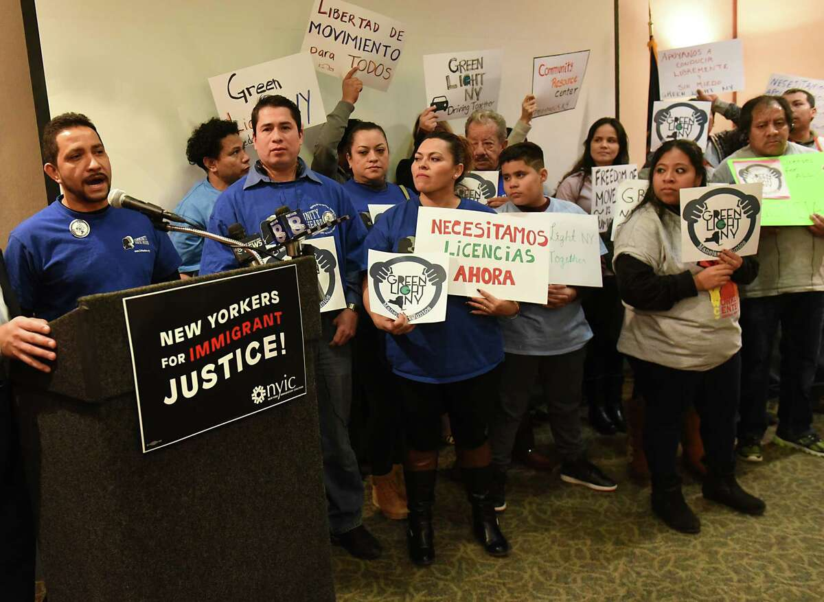 Rey Morales of Orange County, left, speaks during a press conference to call for giving undocumented immigrants drivers licenses at the Empire State Plaza on Tuesday, Jan. 31, 2017 in Albany, N.Y. (Lori Van Buren / Times Union)