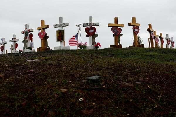 Crosses line Skyway Crossroad and Skyway to commemorate the Camp Fire deaths in Paradise, California, on Wednesday, Jan. 16, 2019.