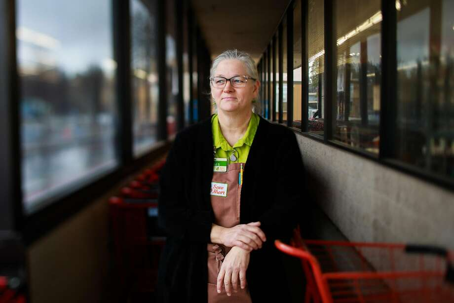 Cheryl Stock-Tadeo, 57, stands outside the Save Mart in Paradise, where she was helping a customer load groceries into a car when she saw an orange glow and smoke billowing in the sky and called 911. Photo: Gabrielle Lurie / The Chronicle