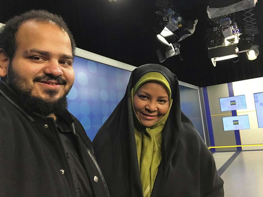 American-born news anchor Marzieh Hashemi (right) smiles as she stands with her son in Tehran, Iran. Photo: Associated Press