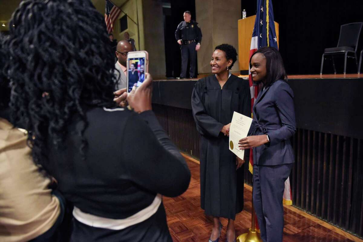 Judge Sharon Aarons, left, with the State of New York Supreme Court, Appellate Division Third Judicial Department, poses for a photo with newly admitted New York State Bar member, Seantyel Hardy, of Washington, D.C., during a ceremony to admit new members into the bar on Thursday, Jan. 17, 2019, in Albany, N.Y. Those admitted to the bar on Thursday represent 34 states, the District of Columbia, Puerto Rico and 35 foreign countries. (Paul Buckowski/Times Union)