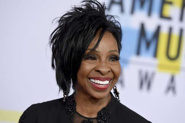 """FILE - In this Oct. 9, 2018 file photo, Gladys Knight arrives at the American Music Awards at the Microsoft Theater in Los Angeles. The seven-time Grammy Award-winner will sing """"The Star-Spangled Banner"""" at this year's Super Bowl, Sunday, Feb. 3, 2019. Knight says she's proud to use her voice to """"unite and represent our country"""" in her hometown of Atlanta.(Photo by Jordan Strauss/Invision/AP, File)"""