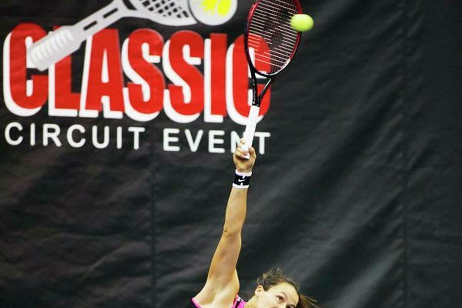 THEOPHIL SYSLO   For the Daily News Tatjana Maria serves the ball to Naomi Broady while playing in the women's championship singles match during the Dow Tennis Classic at the Greater Midland Tennis Center on Sunday.