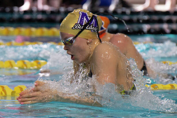Midland High's PJ Day swims the breast stroke leg 01/17/19 in the girls 200-meter medley relay during the District 2-6A swim meet at COM Aquatics. Tim Fischer/Reporter-Telegram