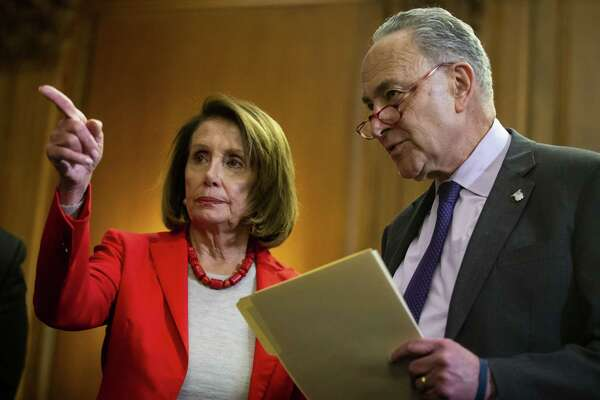 House Speaker Nancy Pelosi, D-Calif., speaks with Senate Minority Leader Chuck Schumer, D-N.Y., on Capitol Hill in Washington, D.C., on Jan. 16, 2019.