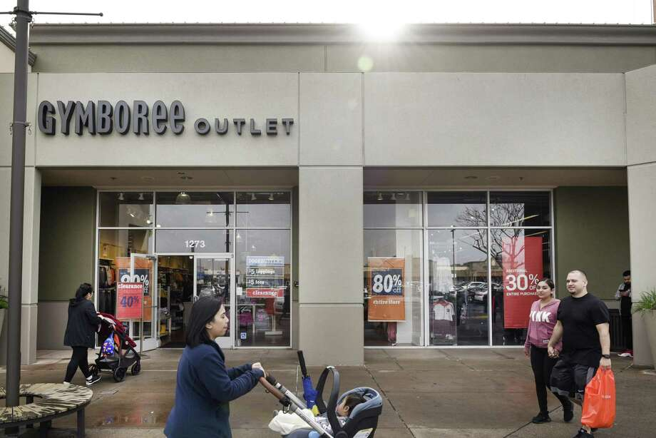People walk past a Gymboree Outlet offering store-wide discounts, in San Leandro, CA, on Thursday January 17, 2019. Gymboree Group filed for chapter 11 bankruptcy late Wednesday and is planning to close all its Gymboree and Crazy 8 brand stores. Its intellectual property, GymboreeÕs online platform and its higher-end Janie and Jack line is being sold to Special Situations Investing Group, an affiliate of Goldman Sachs, pending court approval. Photo: Michael Short / Special To The Chronicle / Michael Short 2019