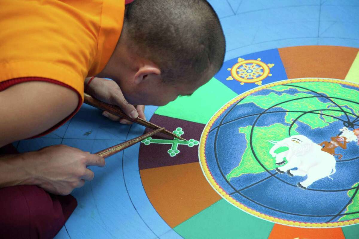 A Tibetan monk at Silver Hill Hospital working on Mandala in 2016.