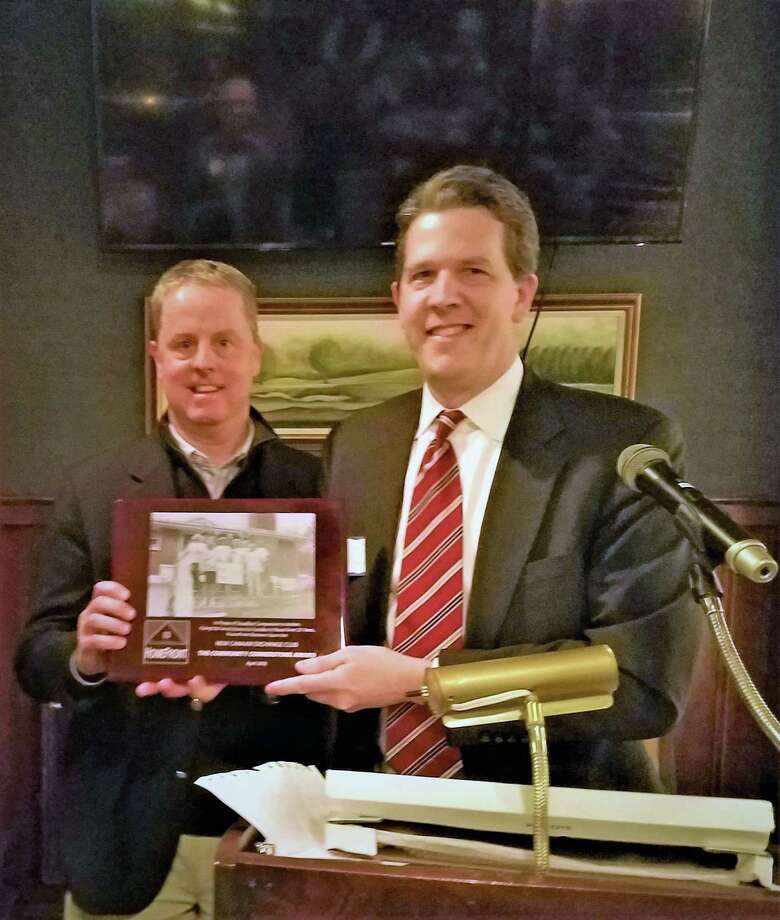 New Canaan Exchange Club President Jeff Platt, left, accepts the Community Cornerstone Award from HomeFront Executive Director Sean O'Brien during a recent meeting held at Woodway Country Club. Photo: Contributed Photo