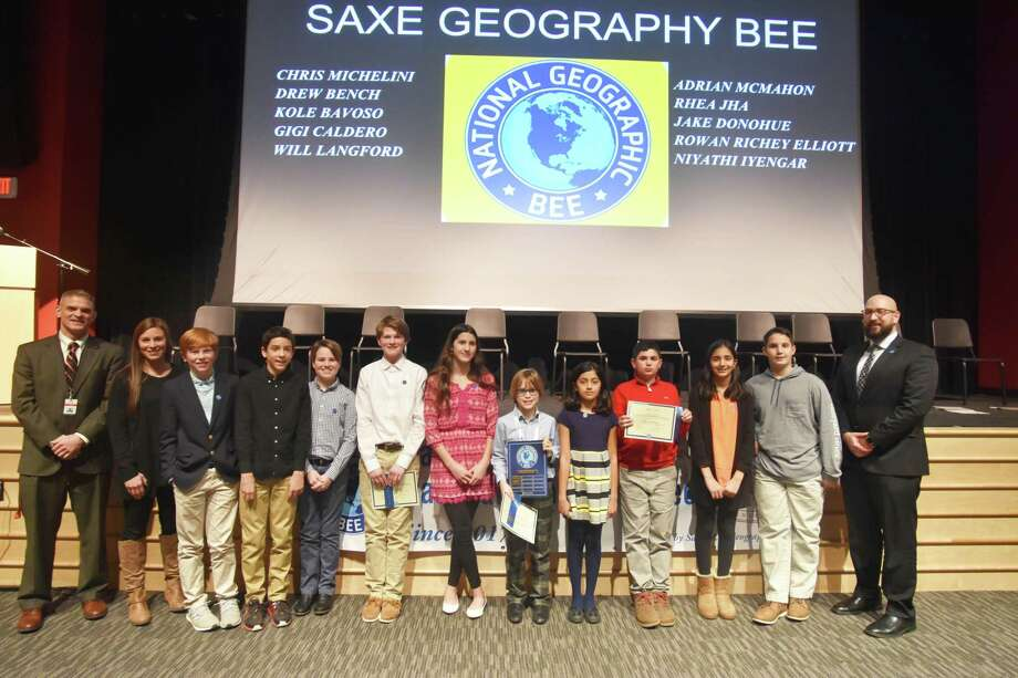 Saxe Middle School Principal Dave Gusitsch, Saxe Middle School 6th Grade Social Studies teacher Christina Fulco, Saxe Middle School students Will Langford, Adrian McMahon, Kole Bavoso, Drew Bench, Gigi Caldero, Rowan Richey Elliot, Niyathi Iyengar, Jake Donohue, Rhea Jha, Chris Michelini, and Saxe Middle School 8th Grade U.S. History teacher Andrew Fusci Photo: Contributed Photo