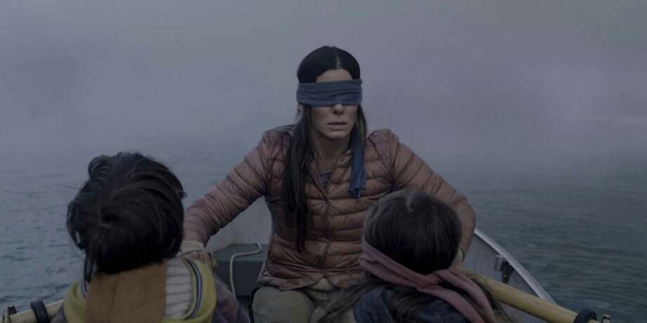 "This image released by Netflix shows Sandra Bullock in a scene from the film, ""Bird Box."" Netflix lifted the usually tightly sealed lid on its viewership numbers in a recent tweet that disclosed 45 million subscriber accounts had watched the thriller, ""Bird Box,"" during its first seven days on the service. That made the film the biggest first-week success of any movie made so far for Netflix's 12-year-old streaming service. (Merrick Morton/Netflix via AP, File) Photo: Merrick Morton / Associated Press File / Netflix"