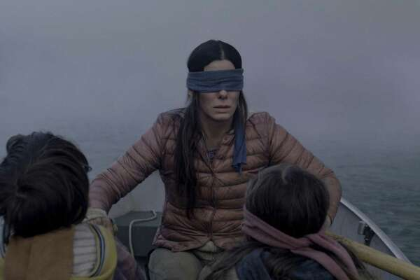 "This image released by Netflix shows Sandra Bullock in a scene from the film, ""Bird Box."" Netflix lifted the usually tightly sealed lid on its viewership numbers in a recent tweet that disclosed 45 million subscriber accounts had watched the thriller, ""Bird Box,"" during its first seven days on the service. That made the film the biggest first-week success of any movie made so far for Netflix's 12-year-old streaming service. (Merrick Morton/Netflix via AP, File)"