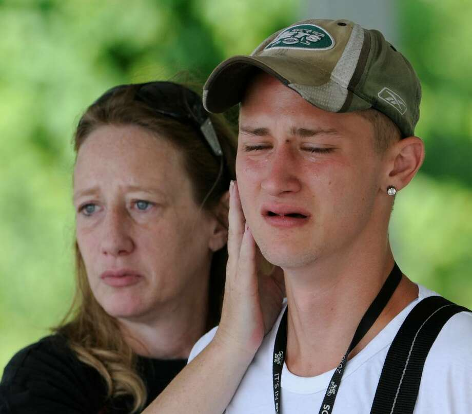 Cody Peck is comforted by his mother, Vess Peck, as the body of his companion who he tried to save was recovered Wednesday from the Hudson River across from the Hudson Shores Park in Watervliet.  (Skip Dickstein / Times Union) Photo: Skip Dickstein
