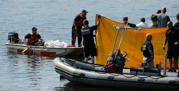 The body of a swimmer is recovered Wednesday from the Hudson River in Watervliet. (Skip Dickstein / Times Union) Photo: Skip Dickstein