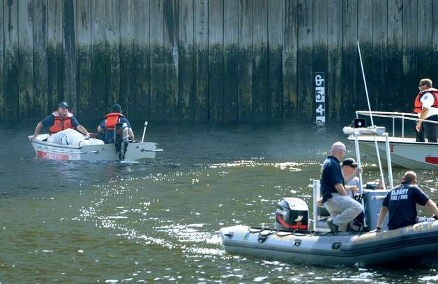 State Police recover the body of a man Wednesday from the Hudson River in Watervliet. (Skip Dickstein / Times Union) Photo: Skip Dickstein