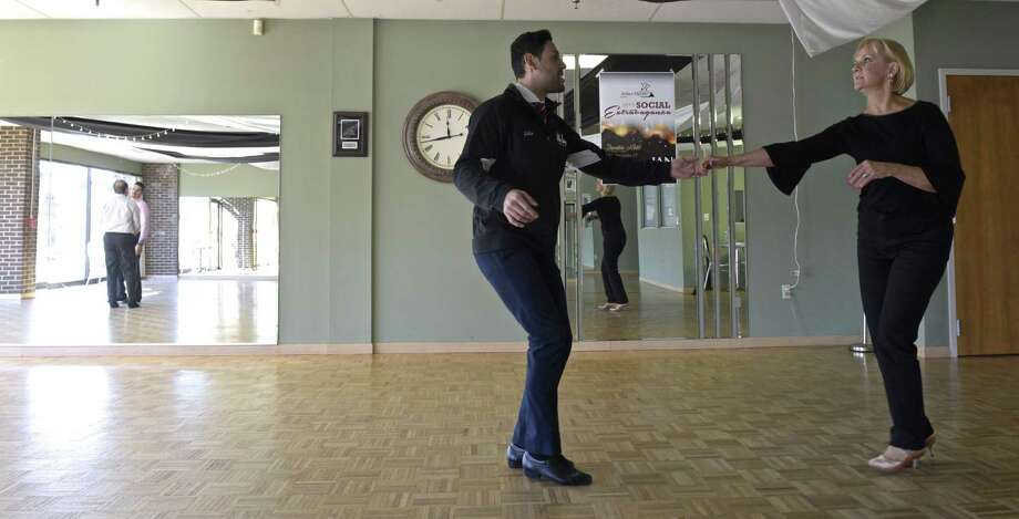 Arthur Murray dance studio Instructor Julio Cesar Sirianni, left, works with Deb Hendrickson, of Fairfield, in the Danbury studio. Arthur Murray offered discounted dance lessons to benefit Housatonic Habitat for Humanity on Friday, January 11, 2019, in Danbury, Conn. Photo: H John Voorhees III / Hearst Connecticut Media / The News-Times