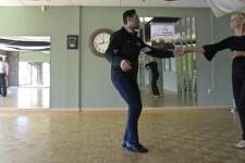 Arthur Murray dance studio Instructor Julio Cesar Sirianni, left, works with Deb Hendrickson, of Fairfield, in the Danbury studio. Arthur Murray offered discounted dance lessons to benefit Housatonic Habitat for Humanity on Friday, January 11, 2019, in Danbury, Conn.