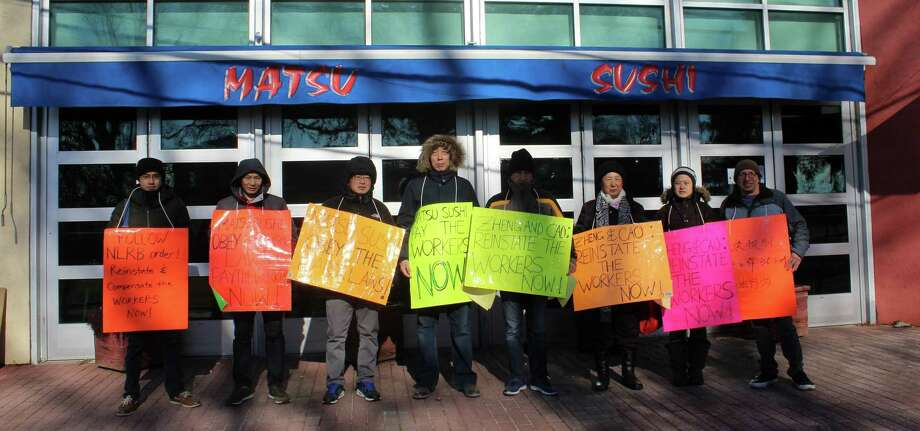 Former Matsu Sushi employees picket outside the restaurant on Jan. 14 in protest of Matsu'?s labor practices. Photo: Sophie Vaughan / Hearst Connecticut Media / Westport News