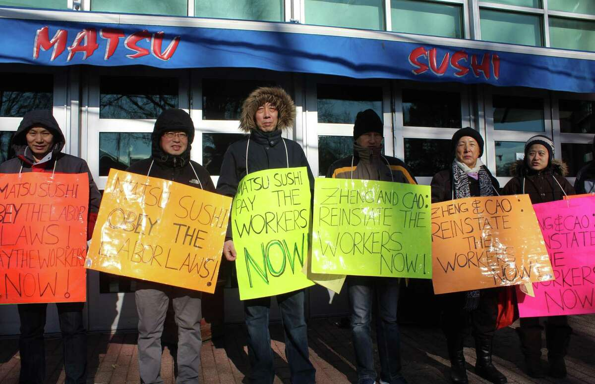Former Matsu Sushi employees picket outside the restaurant on Jan. 14 in protest of Matsu'?s labor practices.