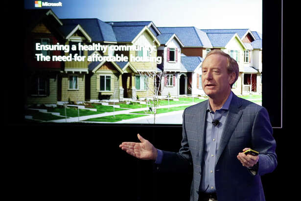 Microsoft Corp. President Brad Smith speaks Thursday, Jan. 17, 2019, during a news conference in Bellevue, Wash., to announce a $500 million pledge by Microsoft to develop affordable housing for low- and middle-income workers in response to the Seattle region's widening affordability gap and to also to address homelessness.
