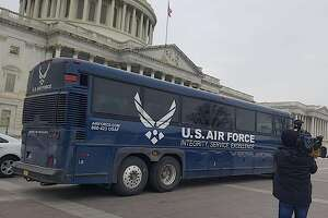 """A US Air Force bus parks on the US Capitol Plaza after being called back following US President Donald Trump decision to scrap Democratic leader Nancy Pelosis foreign travel on January 19, 2019 in Washington. - President Donald Trump clipped the wings of Democratic party leader Nancy Pelosi on Thursday, scrapping her foreign travel plans in a new twist to the government shutdown feud. Pelosi had suggested postponing Trump's January 29 State of the Union address to Congress. Although she cited the shutdown's effect on security, she appeared to want to deny the president one of his chief annual moments in the limelight. In a letter laced with sarcasm and accompanied by his dramatic signature, Trump responded in kind. """"I am sorry to inform you that your trip to Brussels, Egypt, and Afghanistan has been postponed. We will reschedule this seven-day excursion when the Shutdown is over,"""" he wrote. """"I am sure you would agree that postponing this public relations event is appropriate."""" (Photo by Elodie CUZIN / AFP)ELODIE CUZIN/AFP/Getty Images"""