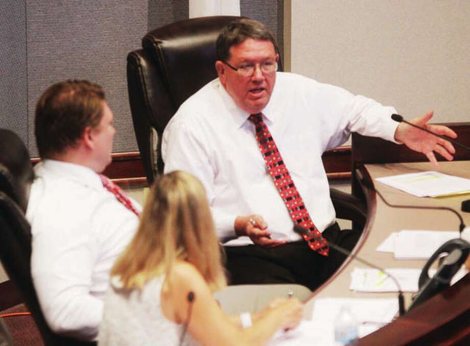 Madison County Auditor Rick Faccin, right, makes a point at a Finance and Government Operations Committee meeting last year. Faccin and members of the Madison County administration argued over reappropriations at Wednesday's County Board meeting. Photo: Scott Cousins | The Telegraph