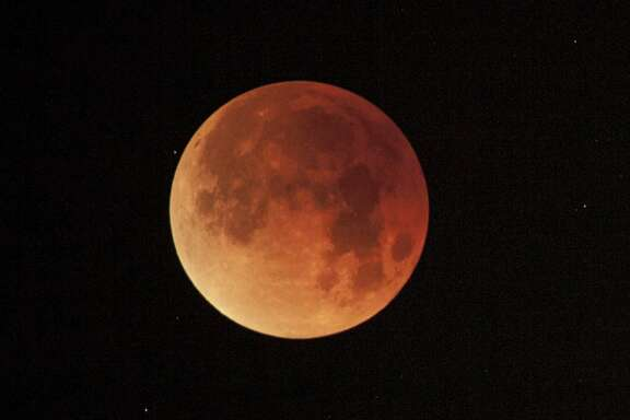 "The Super Blood Moon lunar eclipse as seen in January 2018 in Alameda, Calif. A ""wolf moon"" is said to be what certain Native American and European cultures called the first full moon of January."