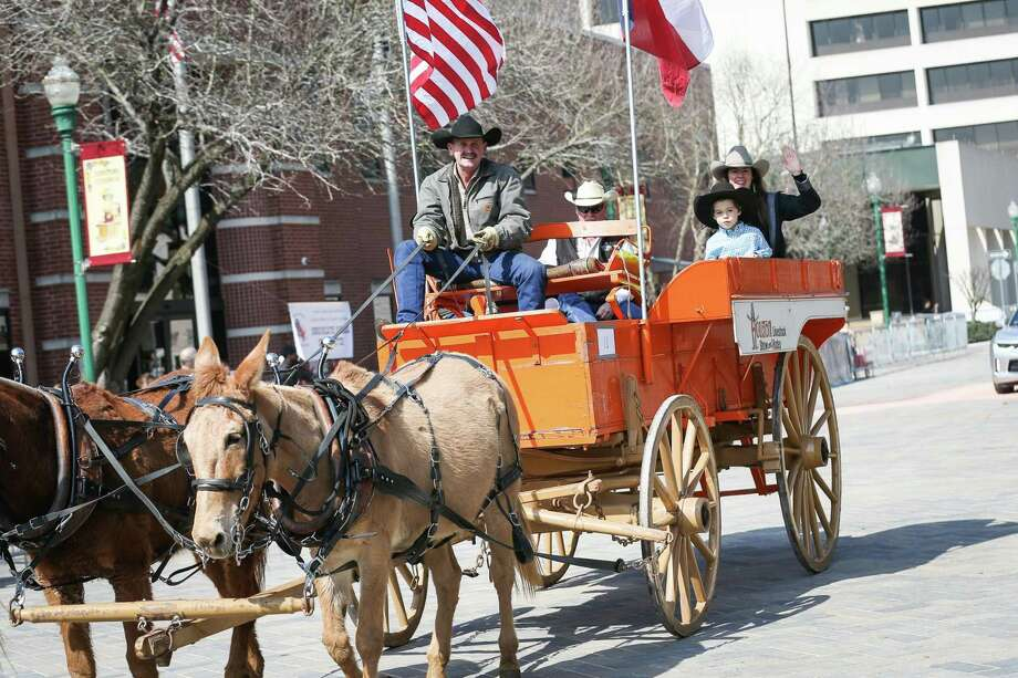 The Official Houston Livestock Show and Rodeo Wagon rolls through downtown Conroe during the 53rd annual Go Texan Parade and Stampede on Saturday, Feb. 17, 2018. Photo: Michael Minasi, Staff Photographer / Houston Chronicle / © 2017 Houston Chronicle