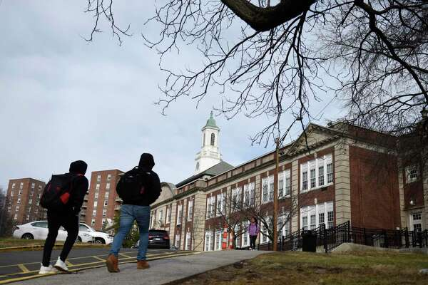 Students leave school after the closing bell at Stamford High School in Stamford, Conn. Thursday, Jan. 10, 2019.