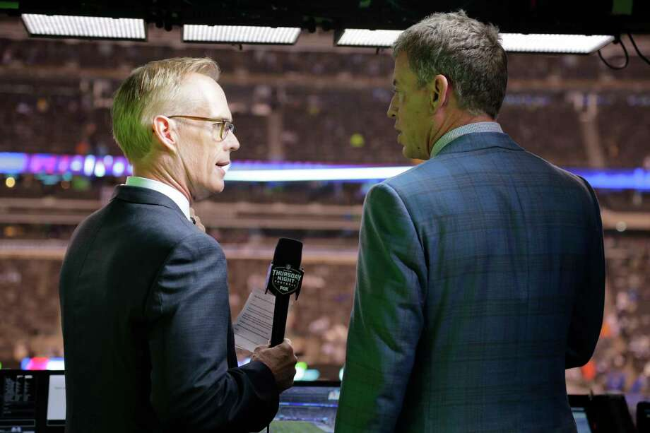 """FILE - This Oct. 11, 2018, file photo shows Troy Aikman, right, and Joe Buck working before an NFL football game between the New York Giants and the Philadelphia Eagles  in East Rutherford, N.J. """"I remember opening weekend when I got home I had a couple college buddies that were raving about the pregame show and how great and fun it was with everyone,"""" said Aikman, who was Cowboys quarterback in 1994 before joining the network seven years later. """"It was refreshing, new and unique, and that set the tone for the network.""""(AP Photo/Frank Franklin II, File) Photo: Frank Franklin II / Copyright 2018 The Associated Press. All rights reserved."""