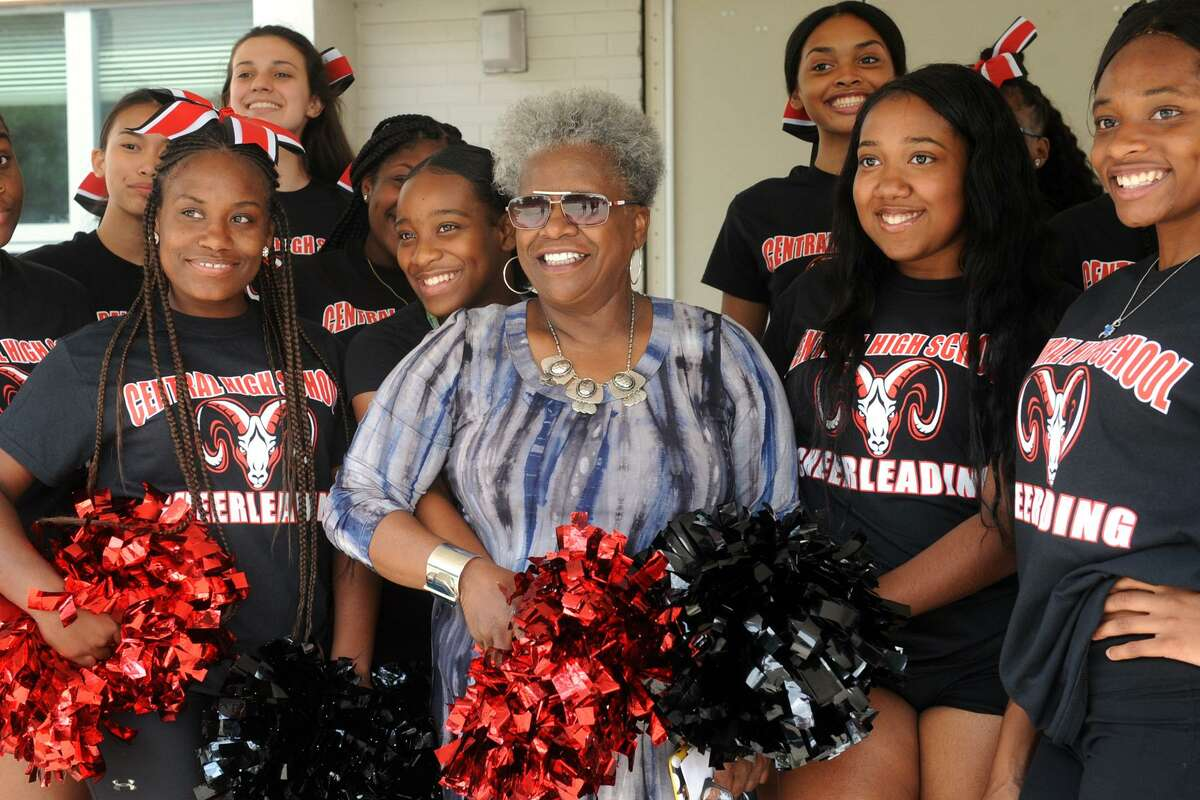 State Sen. Marilyn Moore, a graduate of Central High School, stands with the school?'s cheerleaders at the ribbon cutting ceremony for the newly renovated Central High School, in Bridgeport, Conn. Aug. 31, 2018.