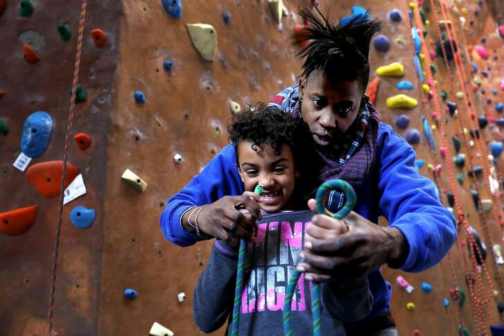 Emily Taylor, 45, teaches Adia Smith, 6, how to tie a knot during a Brown Girls Climbing mini-camp at Great Western Power Company in Oakland, Calif., on Wednesday, January 2, 2019. The program was birthed two years ago when Taylor saw the need to introduce girls of color to the world of rock climbing.