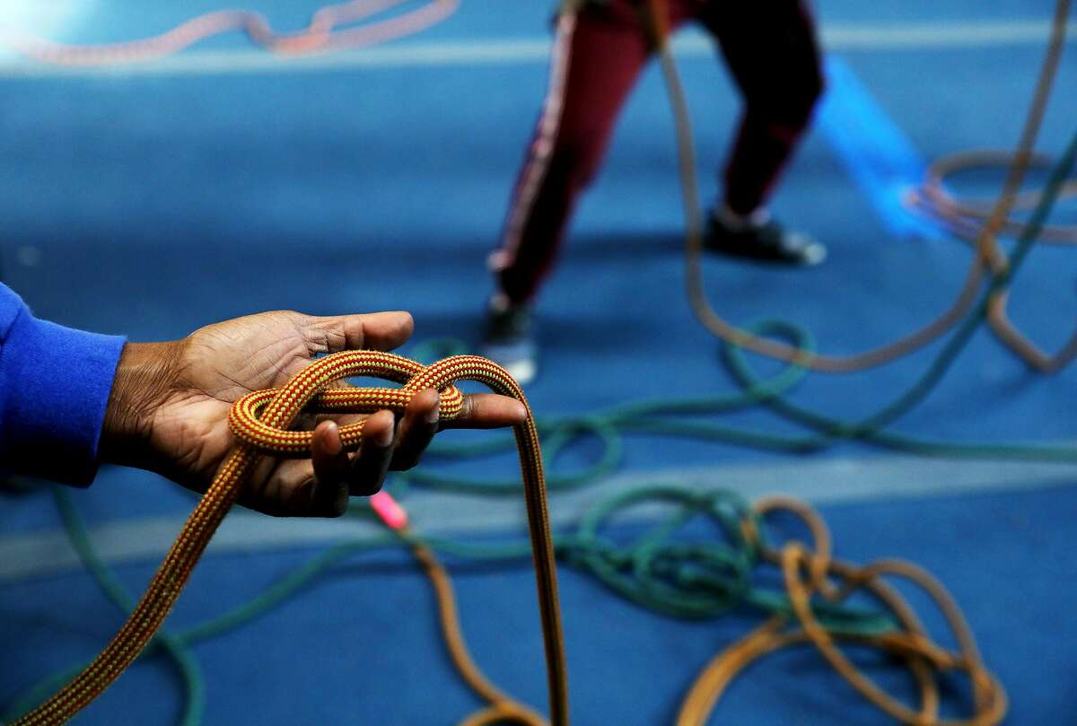 Emily Taylor, 45, instructs students how to tie a knot during a Brown Girls Climbing mini-camp at Great Western Power Company in Oakland, Calif., on Wednesday, January 2, 2019. The program was birthed two years ago when Taylor saw the need to introduce girls of color to the world of rock climbing.