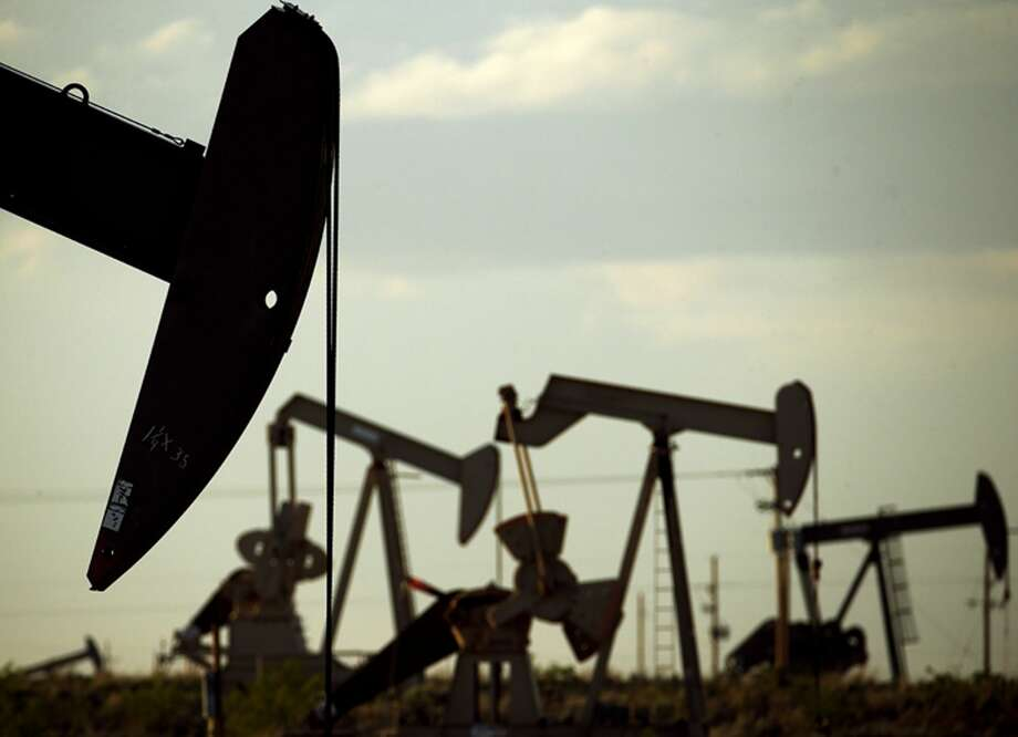FILE - In this April 24, 2015 file photo, pumpjacks work in a field near Lovington, N.M. The analysis found New Mexico captures 20.7 percent of the oil and gas production value as revenue for state and local governments, higher than second-place Texas with 14.9 percent. Photo: Charlie Riedel/Associated Press