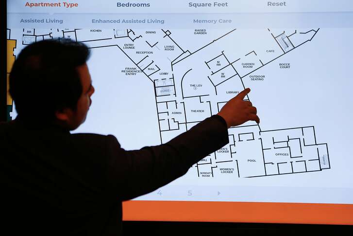 Senior living counselor, Gabriel Marshall, displays digital renderings of floor plans at the new senior housing complex, the Frank Residences, which are under construction at the Jewish Home For the Aged in the Excelsior.  Monday, January 14, 2019 in San Francisco, Calif.