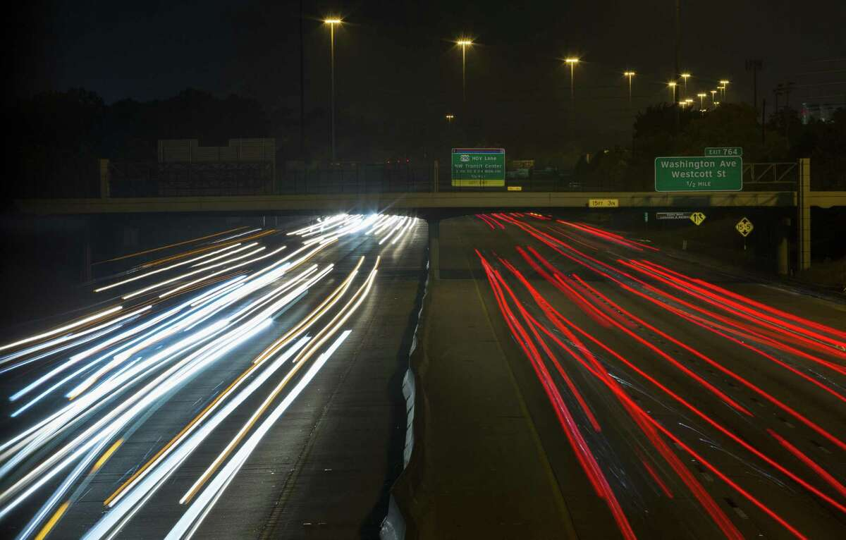 Motorists drive along Interstate 10 near Durham Drive on Aug. 12. Regional transportation officials are planning to connect HOV and transit lanes along I-10, from Loop 610 to downtown.